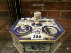 A CONTINENTAL OCTAGONAL ENCRIER DECORATED IN THE FAMILLE ROSE PALETTE WITH LIDDED COMPARTMENTS,