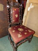 A VICTORIAN CARVED OAK JACOBEAN REVIVAL HIGH BACK CHILD'S CHAIR.