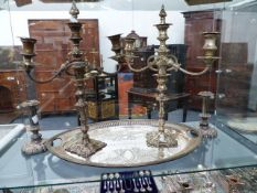A LARGE SILVERPLATED TRAY, A PAIR OF CANDELABRA AND A PAIR OF CANDLESTICKS.