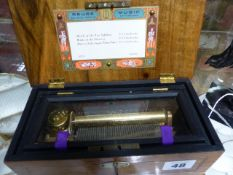 A SMALL SWISS MUSIC BOX PLAYING 3 AIRS BY TCHAIKOVSKY, LABELLED REUGE MUSIC, SAINT CROIX,