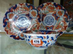 A PAIR OF JAPANESE IMARI SAUCER DISHES (D.30cms.) TOGETHER WITH A SIMILAR DEEP BOWL.