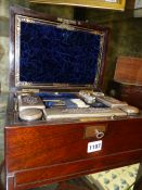 A VICTORIAN ROSEWOOD DRESSING CASE WITH SILVER PLATE FITTINGS, GLASS BOTTLES,ETC.