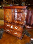 AN ANGLO INDIAN INLAID MINIATURE HARDWOOD TABLE TOP FITTED WRITING CABINET IN THE FORM OF A LINEN
