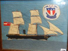 A VINTAGE WOOLWORK PICTURE OF A SAIL/STEAMSHIP, INSET CREST. 32 x 42cms.