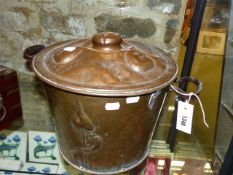 A VINTAGE ARTS AND CRAFTS COPPER COVERED TWO HANDLED COAL BUCKET.