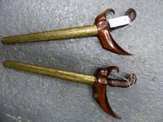 TWO MALAYSIAN KRIS WITH WOOD HANDLES AND BRASS WRAPPED SCABBARDS