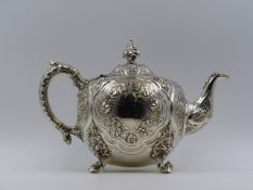 A VICTORIAN EMBOSSED HALLMARKED SILVER THREE PIECE TEA SET 1865 LONDON ROBERT HENNELL III,