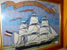 A VINTAGE WOOLWORK PICTURE OF THE SAILING SHIP ELFRIEDA IN MAPLE FRAME TOGETHER WITH PAPERWORK