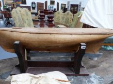 A 19th.C.CARVED WOOD MODEL POND YACHT WITH LEAD WEIGHTED KEEL. L.105cms.