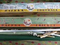 A BOXED FOOTBALL GAME TOGETHER WITH A BOXED BALYNA DISCBAT CRICKET GAME. (2)