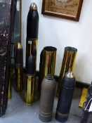 THREE LARGE HEAVY ARTILLERY SHELLS, ONE CASING WITH ENGRAVED TRENCH ART DECORATION TOGETHER WITH