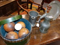 AN ANTIQUE PEWTER LIDDED TANKARD, A PEWTER QUART MEASURE, PEWTER PLATE, AND A SET OF BOWLING WOODS,