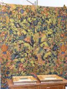 A TAPESTRY WALL HANGING IN THE ANTIQUE STYLE OF BIRDS AND ANIMALS AMIDST FOLIAGE. 184 x 135cms.