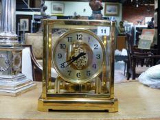 A JAEGER LE COUTRE ATMOS CLOCK IN GILT BRASS CASE. H.23.5cms.