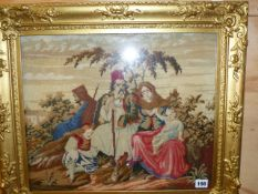 A VICTORIAN NEEDLEPOINT PANEL OF AN EASTERN FAMILY IN GILT FRAME. OVERALL 54 x 62cms.