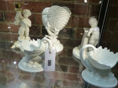 A GROUP OF FOUR ROYAL WORCESTER FIGURINES TO INCLUDE A PAIR OF DOLPHIN SUPPORTED SHELL DISHES,