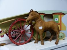 A HAND MADE MODEL GYPSY WAGON, A SIMILAR HAYCART AND A SEWN LEATHER HORSE FIGURE.