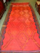 A TRIBAL BROCADED FLAT WEAVE CARPET, POSSIBLY NORTH AFRICAN. 420 x 170cms.