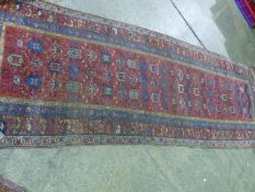 AN ANTIQUE PERSIAN TRIBAL RUNNER 300 X 110 CM