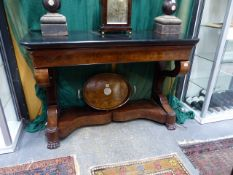 A FRENCH EMPIRE FLAME MAHOGANY CONSOLE OR SERVING TABLE WITH BLACK SLATE TOP. W.130 x H.87cms.