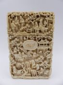 A FINELY CARVED CANTONESE IVORY CARD CASE DECORATED WITH SCENES OF FIGURES AND BUILDINGS IN