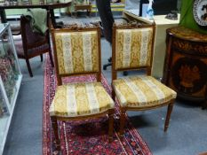 A PAIR OF FRENCH LOUIS XVI STYLE CARVED WALNUT SIDE CHAIRS ON TURNED SUPPORTS.