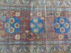 AN ANTIQUE KHOTAN RUG 294 X 154 CM