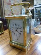AN ANTIQUE CARRIAGE CLOCK WITH ALARM SIGNED CHAS.FRODSHAM, PARIS. No.19869. H.16.5cms.
