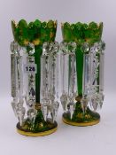 A PAIR OF LATE VICTORIAN GREEN GLASS TABLE LUSTRES WITH FACETED GLASS DROPPERS EMBELLISHED WITH GILT