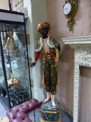 A LARGE CARVED WOOD AND POLYCHROME DECORATED BLACKAMOOR FIGURE. H.166cms.