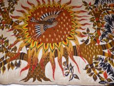 AN ARTISAN TAPESTRY PANEL SIGNED M.RAY OF A STYLISED BIRD ON A SUNFLOWER ENCIRCLED BY TREE BRANCHES.