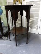 AN ARTS AND CRAFTS OAK TWO TIER OCCASIONAL TABLE IN THE MANNER OF LIBERTYS. TOP 46 x 46cms, H.