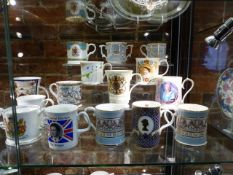 A LARGE COLLECTION OF COMMEMERATIVE CUPS AND MUGS