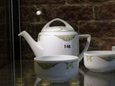 A ROSENTHAL TEA SERVICE CLASSIC ROSE PATTERN COMPRISING TEAPOT, SIX CUPS AND SAUCERS, SUCRIER, ETC.