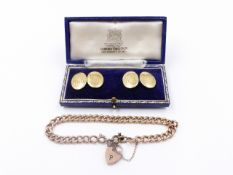 A 9ct ROSE GOLD CHARM BRACELET TOGETHER WITH A PAIR OF PRECIOUS YELLOW METAL CUFFLINKS,