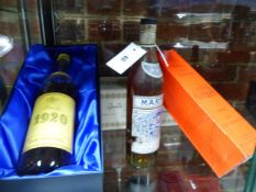 BRANDY AND COGNAC, FOUR BOTTLES TO INCLUDE ONE CHATEAU BARRIERE, ONE MARTELL, ONE 1920 CARVALHO,