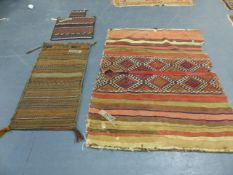 TWO TRIBAL BELOUCH SADDLE BAGS AND A FLATWEAVE PANEL.