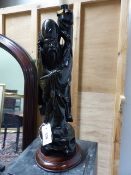 A CHINESE CARVED FIGURE OF A STANDING SAGE WITH WIREWORK INLAY MOUNTED AS A LAMP. H.OVERALL 63cms.