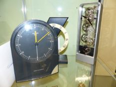 THREE NOVELTY CLOCKS, A JUNGMANS RADIO CONTROLLED CLOCK, AN ART TEMPO CLOCK AND ONE OTHER.