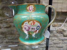 A 19th.C. GREEN GLAZED BALUSTER JUG HAND PAINTED WITH CARTOUCHES OF FLOWERS AND DATED 1869. H.22cms.