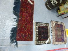 AN ANTIQUE TURKOMAN BAG FACE. 113 x 38cms. TOGETHER WITH TWO BELOUCH BAG FACES. (3)