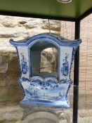 A CONTINENTAL DELFT BLUE AND WHITE POTTERY MODEL OF A SEDAN CHAIR. H.26cms x W.25cms.