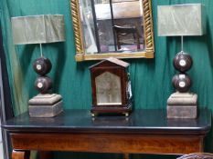 A PAIR OF TABLE LAMPS WITH STONE BASES SURMOUNTED WITH BOWLING WOODS. HEIGHT (INC.SHADES) 67cms.