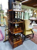 A VICTORIAN MAHOGANY FOUR TIER WHATNOT WITH SPINDLE SUPPORTS AND A DEEP BASE DRAWER. MEASURES 50 x