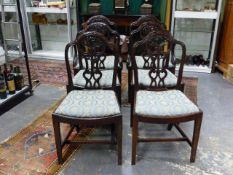 A SET OF SIX ANTIQUE GEO.III.STYLE MAHOGANY ARMCHAIRS WITH CURVED SEATS AND CARVED PIERCED BACKS.