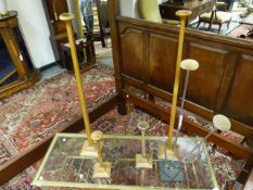 A GROUP OF FOUR ART DECO OAK WIG OR HAT DISPLAY STANDS AND A LATER METAL THREE BRANCH EXAMPLE.