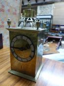 AN ANTIQUE BRASS CASED DESK CLOCK WITH PIERCED AND ENGRAVED DECORATION IN THE MANNER OF THE GUILD OF