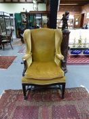 A GOOD QUALITY EARLY 20th.C. GEORGIAN STYLE WING BACK ARMCHAIR. W.69 x H. 110cms.