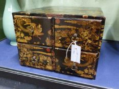 A CHINOISERIE DECORATED SMALL FOUR DRAWER FILR CHEST.