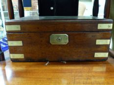 A VICTORIAN MAHOGANY CAMPAIGN TYPE DESK TOP BOX WITH BRASS MOUNTS AND PLAQUE READING LIEUT.T.MADOCKS